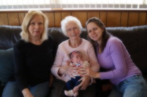 Mom, holding her youngest great-grandchild last year.