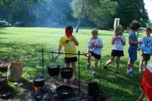 Experiencing colonial life at summer camp.
