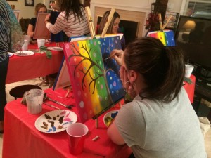 Kristin, creating a masterpiece at the painting party.