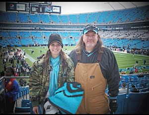 Kristin, enjoying a Carolina Panthers game with her dad.