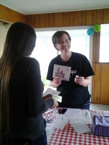 Lydia, talking to a customer about essential oils.