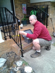 Conley Myers putting the finishing touches on my new hand rail. Love the look. Thanks, Conley.