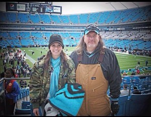 Kristin with her dad making memories at a Panther's game.