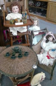 Dolls having a tea party at the Spencer Doll Museum.
