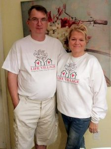 Eddie and Crystal proudly showing off their Life Village shirts.