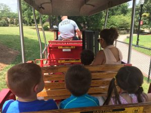 Riding the train at the Kannapolis splash pad park.